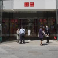 Fast Retailing sharply cuts earnings outlook due to virus outbreak