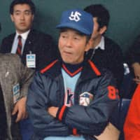 Swallows manager Junzo Sekine sits in the dugout at Tokyo Dome in April of 1988. | KYODO