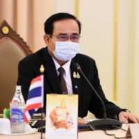 Thai Prime Minister Prayut Chan-ocha takes part in a special Cabinet meeting to discuss measures to stop the spread of the COVID-19 at the Government House in Bangkok. | ROYAL THAI  GOVERNMENT / VIA AFP-JIJI