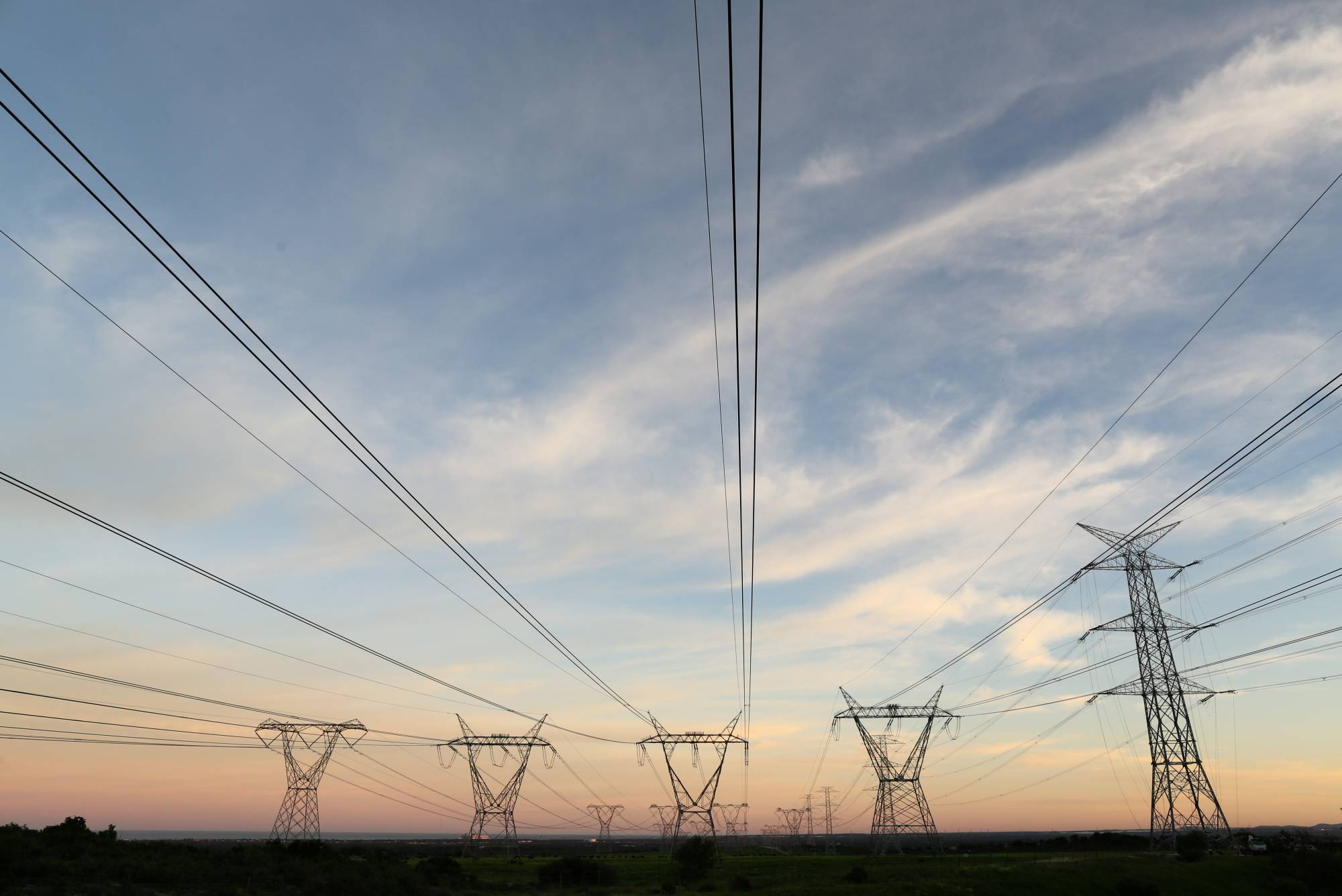 Electricity pylons carrying power from the Koeberg nuclear power plant in South Africa | REUTERS