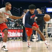 Wizards forward Rui Hachimura practices before a game against the Hawks on March 8 in Washington. | KYODO