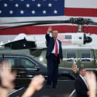 U.S. President Donald Trump waves after his visit to U.S. troops based in Osan Air Base in South Korea, on June 30. | POOL / VIA REUTERS
