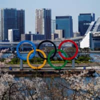Rings of uncertainty: Olympic rings sit at Odaiba Marine Park in Tokyo on March 25, one day after the announcement of the games' postponement due to the outbreak of the new coronavirus. | REUTERS