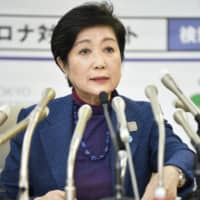 War of words: Tokyo Gov. Yuriko Koike speaks at a news conference on March 25. | KYODO