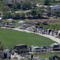 Displaced Syrians drive back to their homes, as some are afraid of COVID-19 outbreaks in crowded camps, in Dayr Ballut on Saturday. | REUTERS