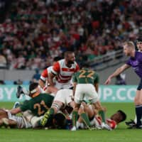 Michael Leitch looks toward the referee during a scrum in the Rugby World Cup quarterfinal between Japan and South Africa on Oct. 19, 2019, in Tokyo. | DAN ORLOWITZ