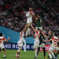 Michael Leitch (above, left) is lifted into the air during a lineout in the 2019 Rugby World Cup quarterfinal between Japan and South Africa on Oct. 19, 2019, at Tokyo Stadium. | DAN ORLOWITZ