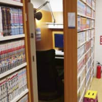 Japanese internet cafes wait for long-term guests to move out before closing