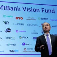 SoftBank Group Corp. Chief Executive Masayoshi Son attends a news conference in Tokyo in November 2018.  SoftBank Group Corp. forecast a ¥1.35 trillion operating loss for the fiscal year ended in March, a sign of how badly Son's bets on technology startups have been battered in recent months. | REUTERS