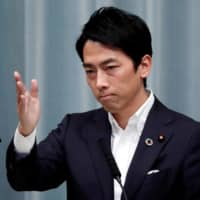 Environment Minister Shinjiro Koizumi attends a news conference at the Prime Minister's Office in Tokyo in September.  | REUTERS