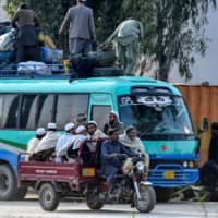 Islamic worshippers leave after attending a three-day annual Tablighi Jamaat religious gathering in Lahore, Pakistan, on March 13. Pakistani authorities are searching for tens of thousands of worshippers who attended the event just as COVID-19 was taking root in Pakistan. | AFP-JIJI