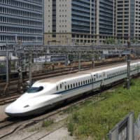 A bullet train travels along a track in Tokyo. | GETTY IMAGES / VIA BLOOMBERG