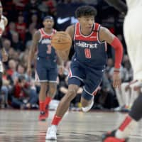 Wizards forward Rui Hachimura dribbles against the Trail Blazers during a March 4 game in Portland, Oregon. | AP / VIA KYODO