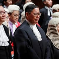 Judges of the Court of Final Appeal: (From left) Andrew Cheung Kui-nung, Robert Ribeiro and Secretary of Justice Teresa Cheng. | REUTERS