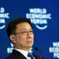 Chinese Vice Premier Han Zheng attends a session at the 50th World Economic Forum annual meeting in Davos, Switzerland, in January. | REUTERS