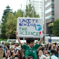 Environmental activists gather in Tokyo in September. Policies that could lead to long-term environmental changes are taking a back seat amid the coronavirus outbreak, and some activists worry about the movement losing momentum. | RYUSEI TAKAHASHI