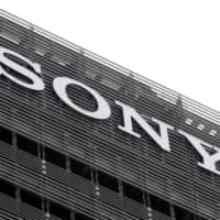 The Sony Corp. logo is displayed atop a building in Tokyo, Japan in September 2019.  | BLOOMBERG