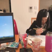 Junko Sugiyama has been working from home alongside her 11-year-old daughter, Miyu, since schools around Japan closed on March 2. | COURTESY OF JUNKO SUGIYAMA