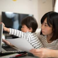Many parents in Japan are finding themselves having to adjust to juggling work duties and their children during the COVID-19 pandemic. | GETTY IMAGES