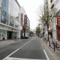 An entertainment district of Tenjin in the city of Fukuoka was almost empty last Saturday, after the state of emergency was declared for Tokyo and other prefectures, including Fukuoka. | KYODO