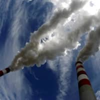Smoke billows from the chimneys of a coal-fired power plant in Poland. | REUTERS