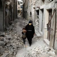 Displaced Syrians return to ruins rather than risk exposure to virus