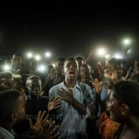 AFP's Yasuyoshi Chiba wins top World Press Photo prize for Sudan protest picture