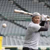 Tigers outfielder Kosuke Fukudome practices at Koshien Stadium in Nishinomiya, Hyogo Prefecture. | KYODO
