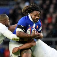 France's Mathieu Bastareaud runs with the ball during a Six Nations match between France and England on Feb. 10, 2019, at Twickenham Stadium in London. | REUTERS