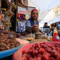 A Yemeni vendor waits for costumers in the old city market of the capital Sanaa on Saturday.  | AFP-JIJI