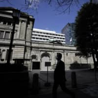 Central banks may soon resort to a policy of direct financing in which they buy public debts amid a crisis. | BLOOMBERG