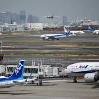 Falling demand for air travel due to the coronavirus pandemic has forced ANA Holdings Inc. to cut its earnings estimate sharply for the 2019 business year through March. | AFP-JIJI