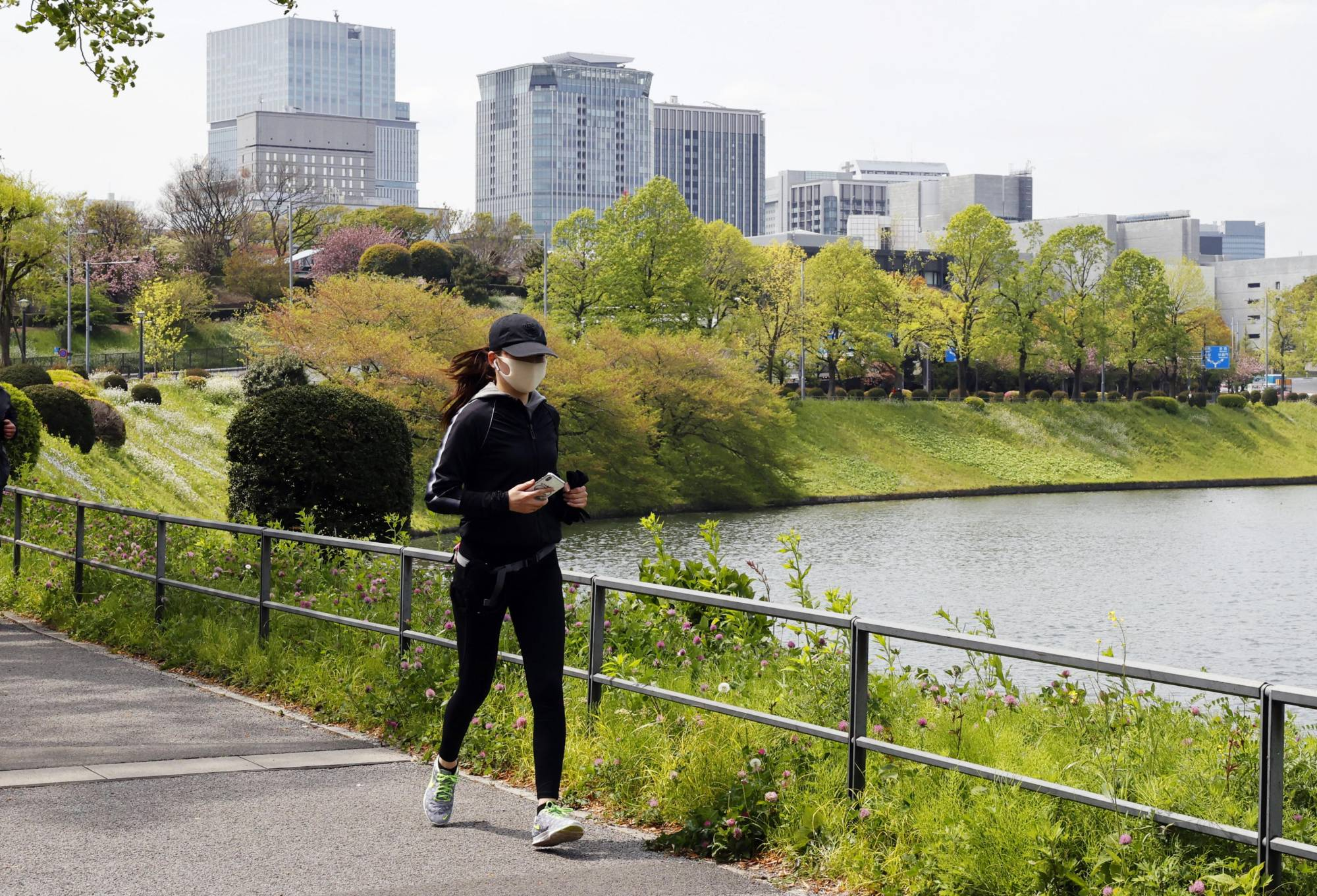 A runner jogs around the Imperial Palace in Tokyo last week.   KYODO