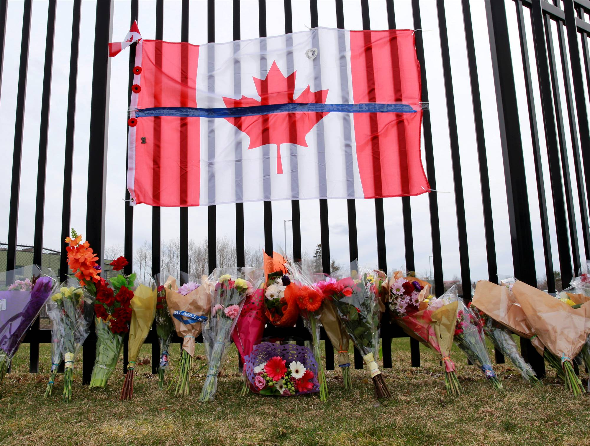 A memorial for Constable Heidi Stevenson outside the Royal Canadian Mounted Police Headquarters in Dartmouth, Nova Scotia, on Monday  | REUTERS