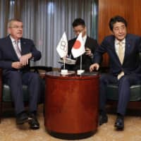 Prime Minister Shinzo Abe and International Olympic Committee President Thomas Bach hold talks in New York last Sept. 23. | KYODO