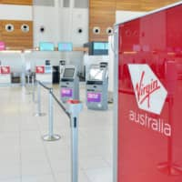 The empty check-in area for Virgin Australia at Adelaide Airport on Tuesday   AFP-JIJI