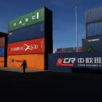 A China Railway Express Co. shipping container stands with other containers at Duisport port in Duisburg, Germany. | BLOOMBERG