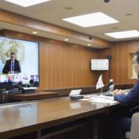 Japan's farm minister Taku Eto participates in a videoconference with Group of 20 farm ministers on Tuesday evening to discuss steps deal with the COVID-19 pandemic. | AGRICULTURE, FORESTRY AND FISHERIES MINISTRY / VIA KYODO