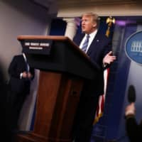 A drug that U.S. President Donald Trump championed for use in the fight against the coronavirus provides no benefit and potentially puts patients at risk, according to an analysis pending expert review. | REUTERS