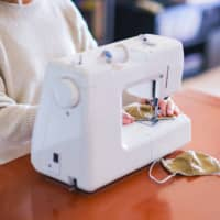A stitch in time: Sewing machines have been selling like hotcakes as people attempt to produce their own cloth face masks at home amid the existing shortage of masks in stores nationwide. | GETTY IMAGES