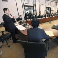 Aichi Gov. Hideaki Omura (left) speaks during a meeting of the prefecture's task force dealing with the COVID-19 outbreak earlier this month. | KYODO