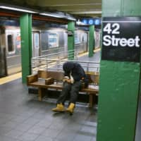 A Metropolitan Transportation Authority official says the city's leadership has put the MTA in a difficult position because it hasn't sufficiently protected the homeless in shelters from the coronavirus and that, as a result, some feel safer in the subway. | REUTERS