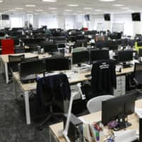 The office of an information technology company in Tokyo is quiet on Feb. 28 after most employees began working at home amid the spread of COVID-19. | KYODO