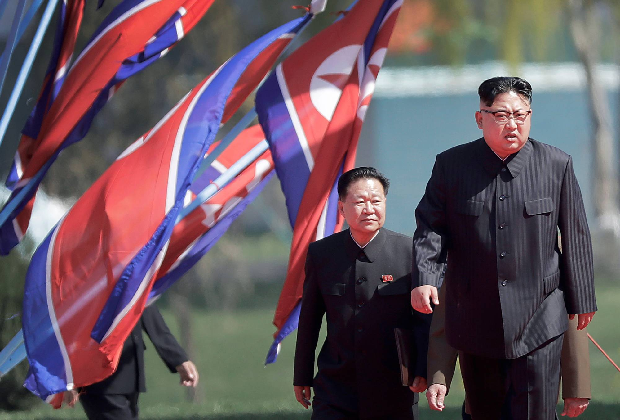 North Korean leader Kim Jong Un and Choe Ryong Hae, vice-chairman of the central committee of the Workers' Party, arrive for the official opening of the Ryomyong residential area, in Pyongyang, North Korea, on April 13. | AP