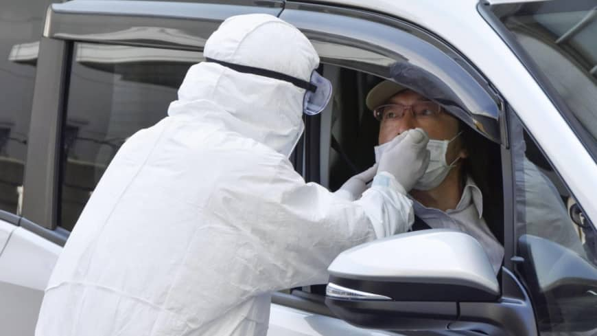 Experts in Japan call for more coronavirus tests as positive rate rises