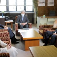 Policy chiefs of four opposition parties hold a meeting at the Diet in Tokyo on Thursday.  | KYODO