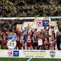Vissel Kobe players celebrate after winning the 99th edition of the Emperor's Cup on Jan. 1 at Tokyo's new National Stadium. | REUTERS