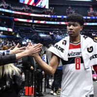 Wizards forward Rui Hachimura greets fans after a game against the Bulls on Feb. 11 in Washington. | USA TODAY / VIA REUTERS