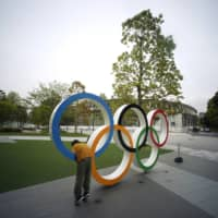 Olympic organizers in rough waters a month after delay of Tokyo Games
