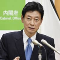 Face of Japan's economic response to virus cancels appearances after contact with infected staffer